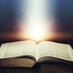 Light flares illuminating the Holy Bible.